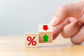 Where are rates headed? red green arrow cube half flipped next to percentage sign cube